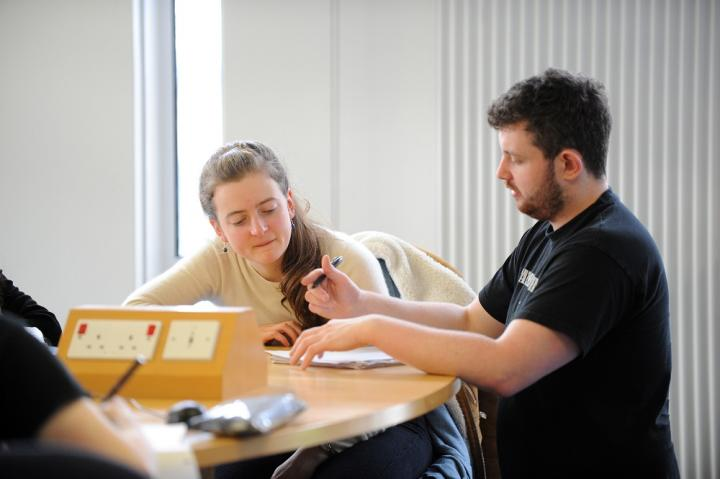 Tutor helping a student in a workshop