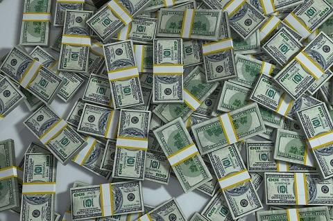 pile of dollars spread out