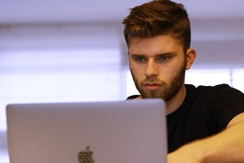 Man studying on his computer