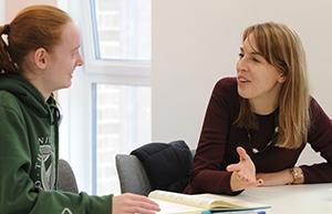A student chatting with the Student Learning Advisor in the Maths Hub