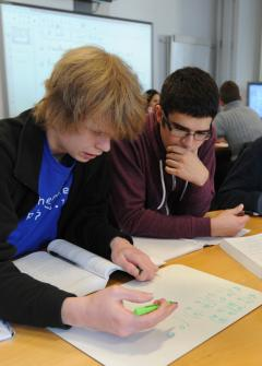 Students working on a problem in an Introduction to Linear Algebra workshop.