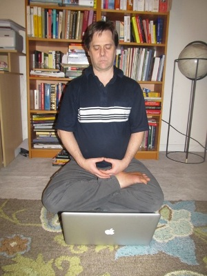 Todd in half-lotus with laptop