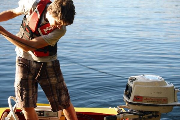 Man starting outboard motor